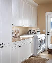interior minimalist laundry room idea with wall units and vanity