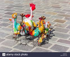 brightly painted metal bird garden ornaments on sale in a weekly