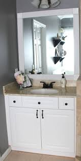 my enroute life framimg our master bathroom builder grade mirrors