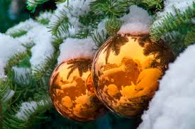 gold snow covered tree ornaments reflect santa fe adobe