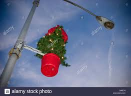 decorations attached to a light pole on a city