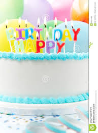 celebration cake with candles spelling happy birthday stock photo