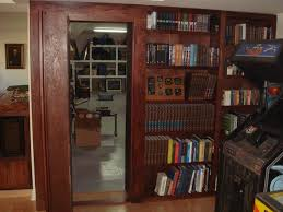 invisidoor hidden door bookcase home gym milwaukee by custom