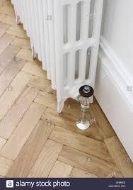 Herringbone Laminate Floor White Radiator And Herringbone Parquet Wooden Flooring