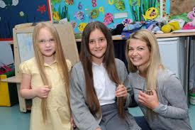 sisters have hair cut for little princess trust from hereford times
