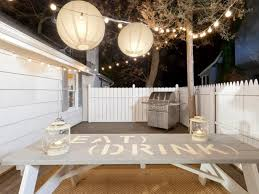 small backyard ideas with unique outdoor string lights and ball