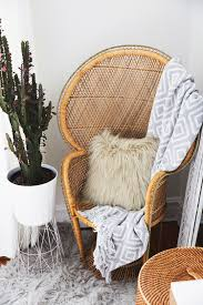wooden woven accent chair and potted cactus love the mix of