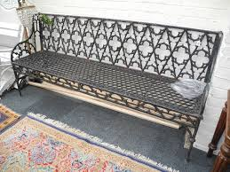 a victorian cast iron garden bench in coalbrookdale style with