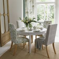small dining room ideas with round dining table and covered dining