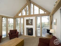 carpenter oak frame design timber house plans concepts living room interior with exposed timber frame and glazed gable end