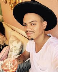 evan ross with wife ashlee simpson as she lifts up baby jagger