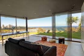 floor to ceiling glass doors spend a luxury family vacation in freshwater beach villa sydney