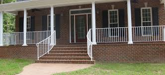white aluminum wrought iron type rails with curved step rails