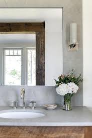 reclaimed wood vanity with concrete framed mirror cottage bathroom