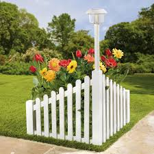 white wood corner fence with solar powered light it is nice