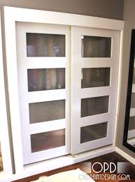 Space Saving Closet Doors Four Glass Panel Sliding Closet Door With White Frame As Space