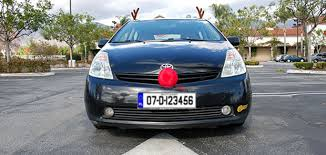 reindeer car with reindeer nose still on his car just taking the at