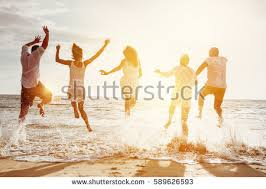 happy family friends running jumping stock photo 589626593