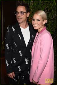 cocktail party photography robert downey jr u0026 noomi rapace u0027s bold suits capture our