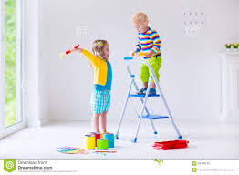 children painting walls at home stock photo image 56408102