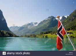 sailing on the green lake and norwegian flag olden fjordland