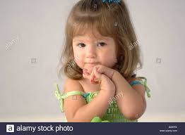 cute 2 year old hairstyles fir boys close up portrait of a 2 year old girl with brown hair stock photo