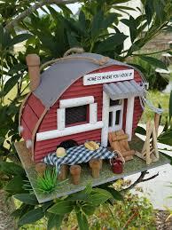 backyard camper birdhouse has the look of a backyard camper cozy
