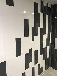large subway tile installed vertical daltile elevare el44 carbon
