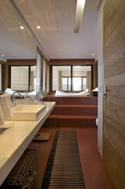 small bathroom design with vanity and vertical mirror in the
