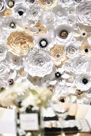 black white and gold flower wall is the perfect backdrop for a