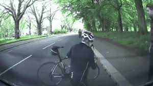 an idiot riding a bicycle crashes into a stationary car gif on imgur
