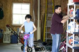free picture man organizing garage son play