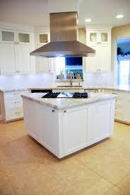 granite countertop white shiny cabinets glacier bay faucet