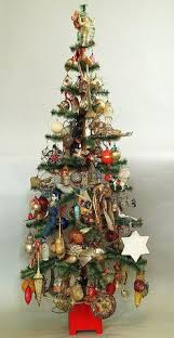 Retro Christmas Tree Toppers - antique german feather tree stand made of tin with nativity