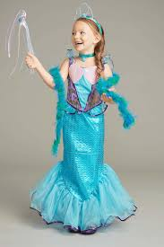 kids mermaid and sea creature costumes chasing fireflies