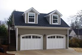 garage additions are by far the most commonly built outbuilding