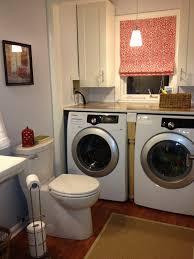 White Wash And Dry Machine On Laminate Flooring Under Grey Board