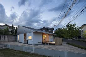 japanese house has rooms set in wooden boxes tass