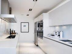 modern white galley kitchen with bulthaup cabinetry kitchen