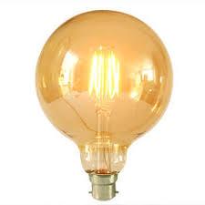 large globe light bulbs large gold globe squirrel cage led light bulb bc