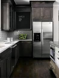 grey subway tile backsplash with dark cabinets outofhome