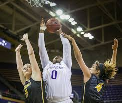 photos no 17 washington dribbles past no 25 missouri 79 66 chantel osahor is fouled on the put back in the first half against missouri left