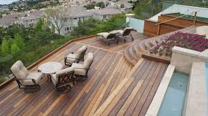 invisible rail patio contemporary with flowers brown deck tiles