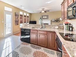 craftsman kitchen with kitchen peninsula u0026 high ceiling in