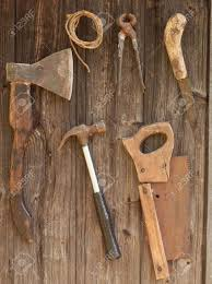 antique rusty tools on an old wooden desk stock photo picture and