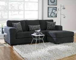 this dark gray sectional sofa is covered in a soft chenille and