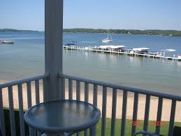 3 bedroom lake charlevoix condo with great vrbo view from balcony includes grill table and two chairs beach right out front