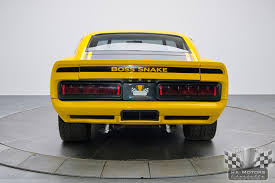 Yellow Mustang With Black Stripes Modernized Classic 1970