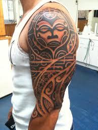 tribal with sun on left half sleeve for