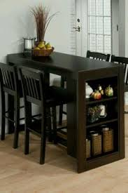 counter height desk with storage a counter height eating area that also serves as a desk work and